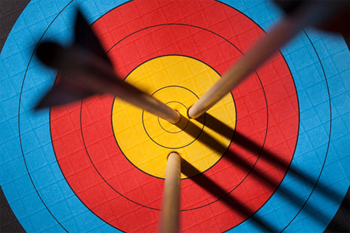 Three arrows on an archery target symbolising effective psychotherapy