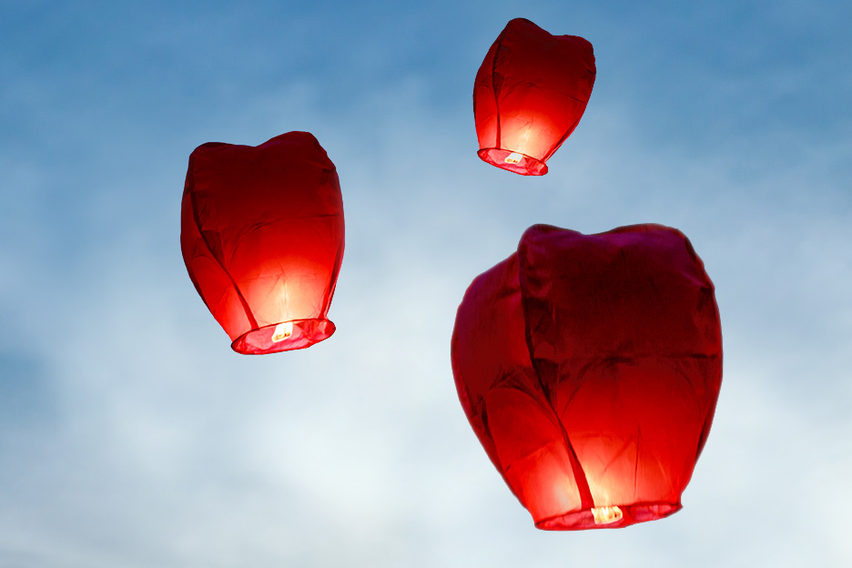 Three red lanterns in the sky symbolising effective pain management