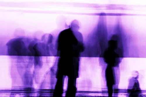 Distorted human shadow on a purple background - psychosis