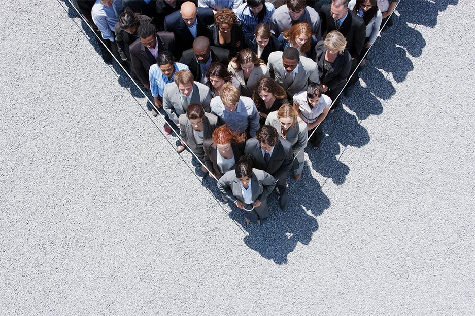 Business men and women trapped behind a rope, symbolising workplace stress